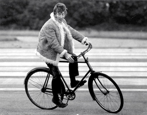 John Lennon Rides a bicycle