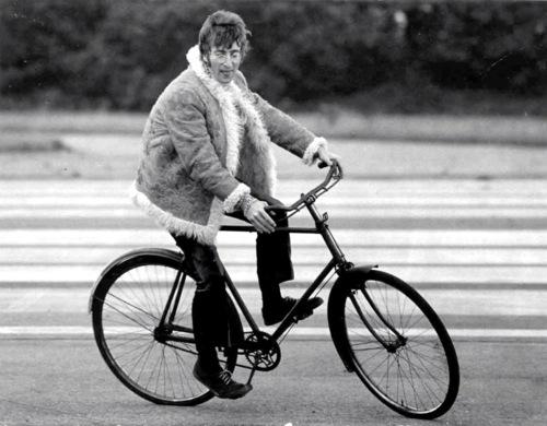 John Lennon Rides a bicycle